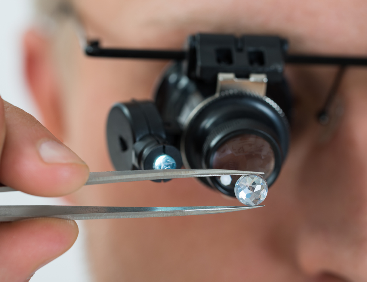 High quality GIA-certified diamond being inspected by Jeweler