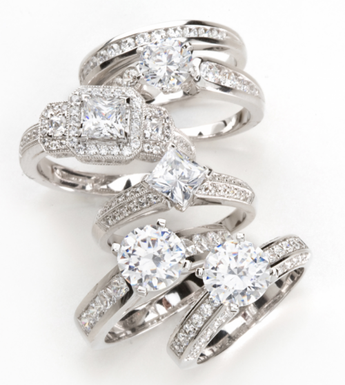 Clear quality diamond engagement rings with princess cut and round diamonds in white gold ring settings