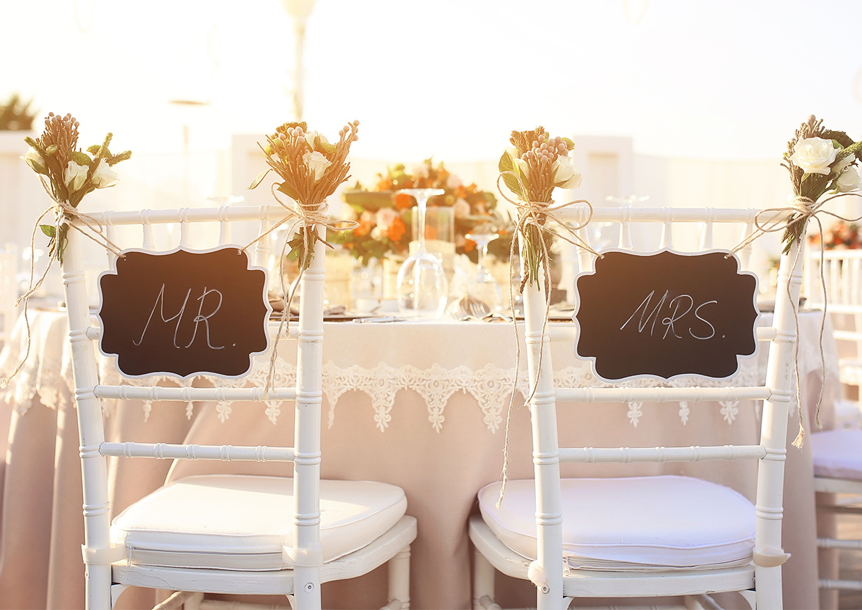 Mister and Misses Newly Weds wedding chairs at the reception