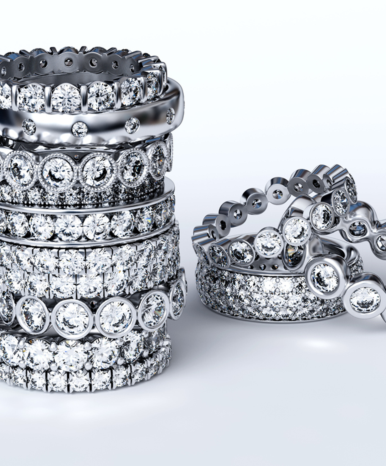 18 karat white Gold Diamond wedding bands stacked on one another