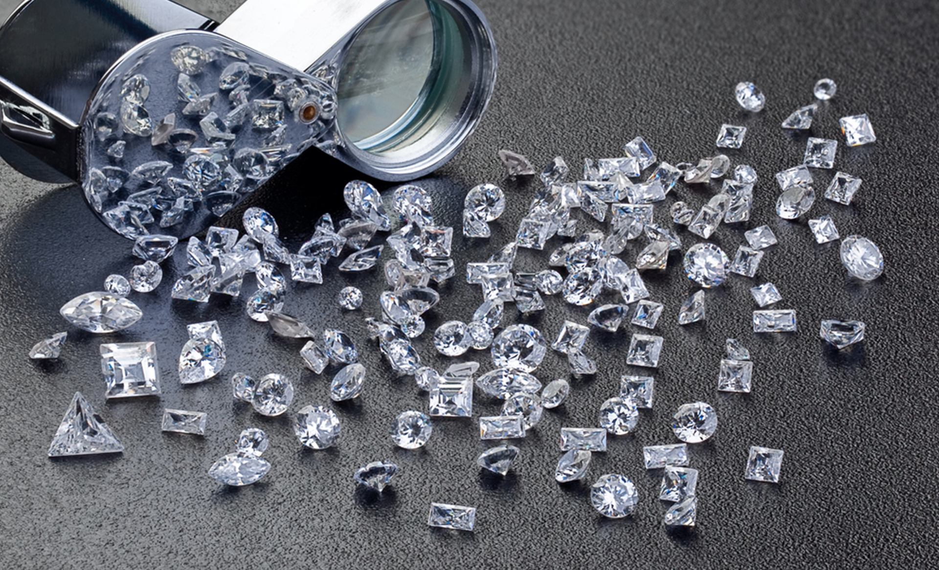 Lab grown, certified GIA diamonds loose on a table