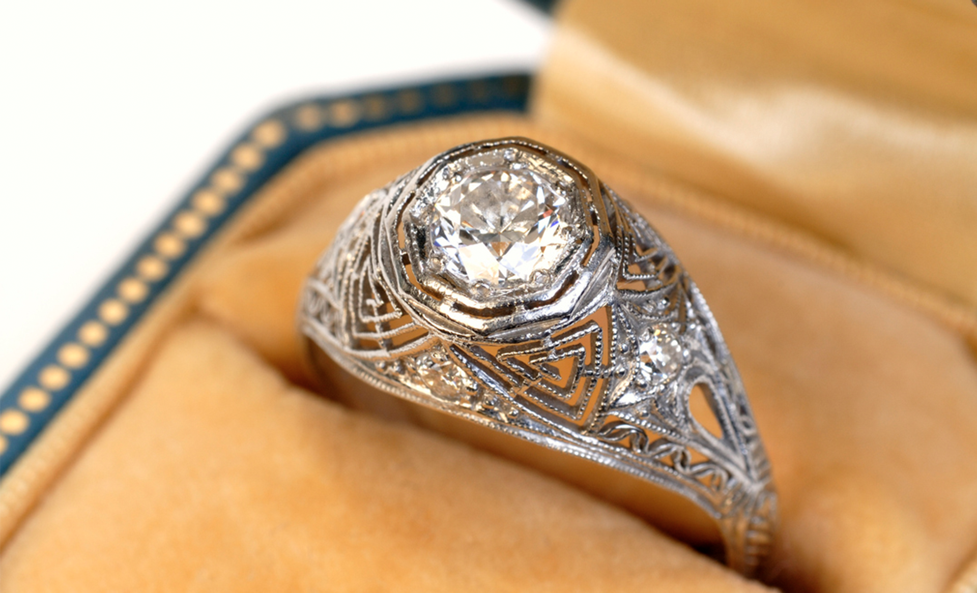Rare vintage, one-of-a-kind, hand-crafted engagement ring with 14 carat white gold filigree style metal work base